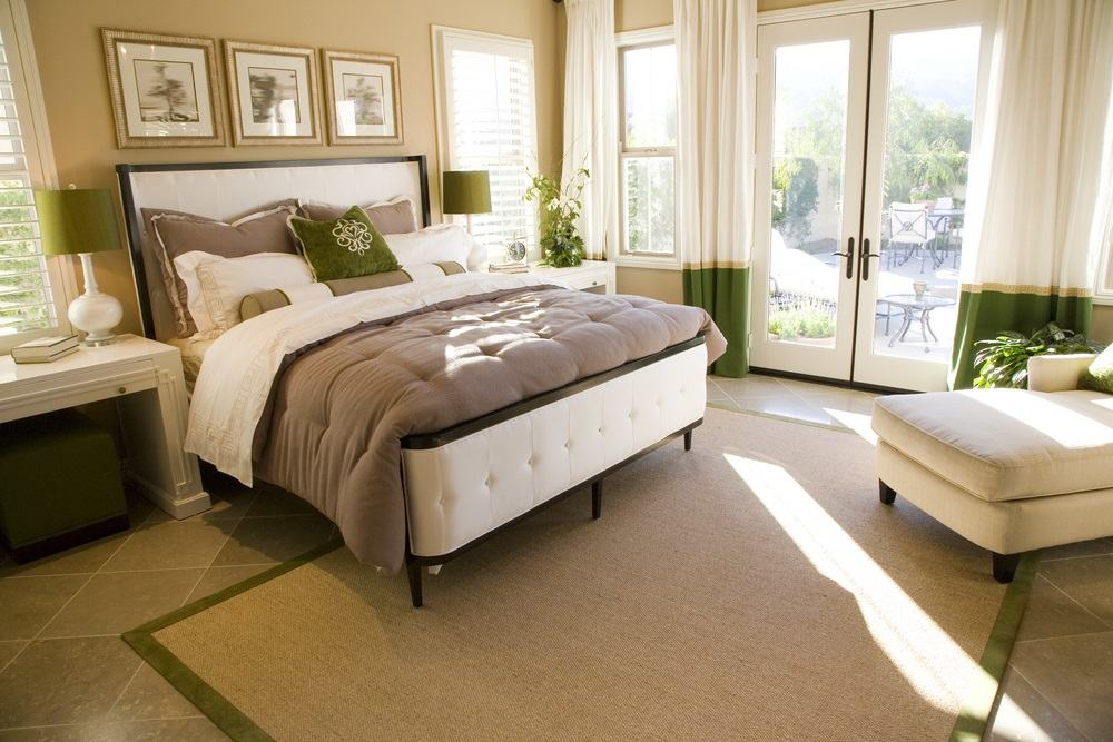 Bedroom with white green theme door to balcony