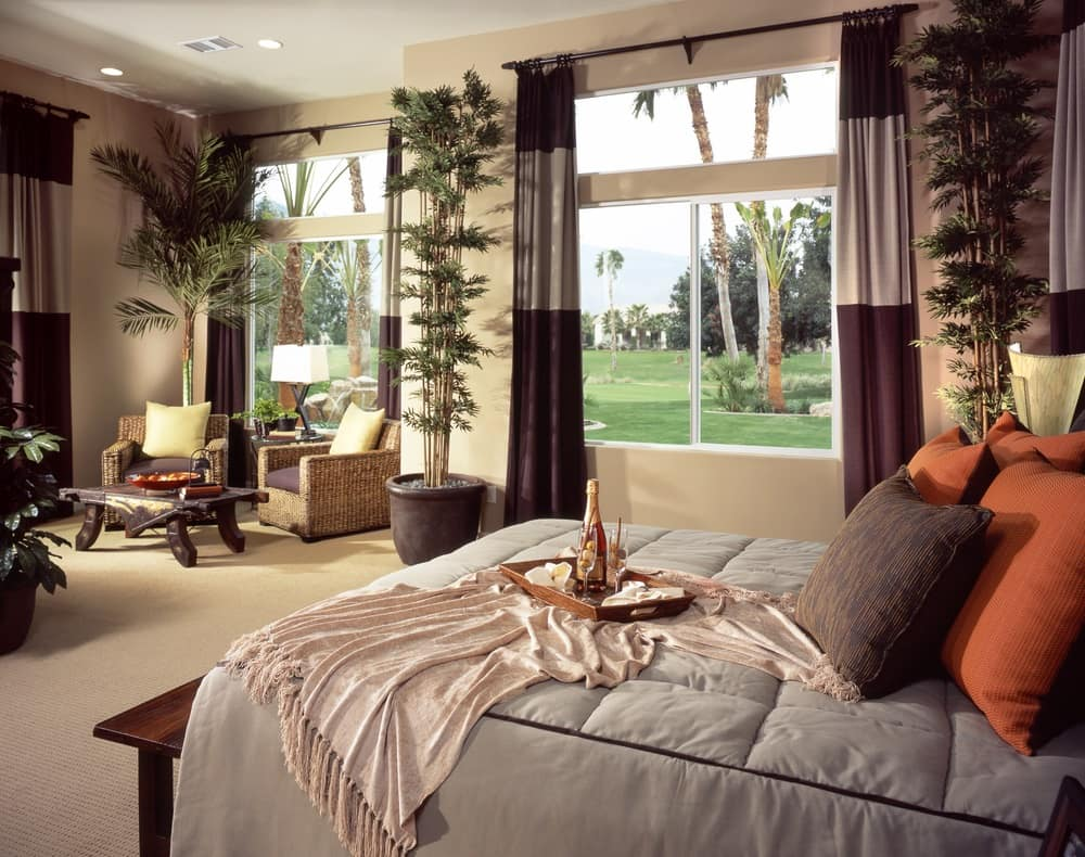 Large bedroom high ceiling large windows overlooking lawn