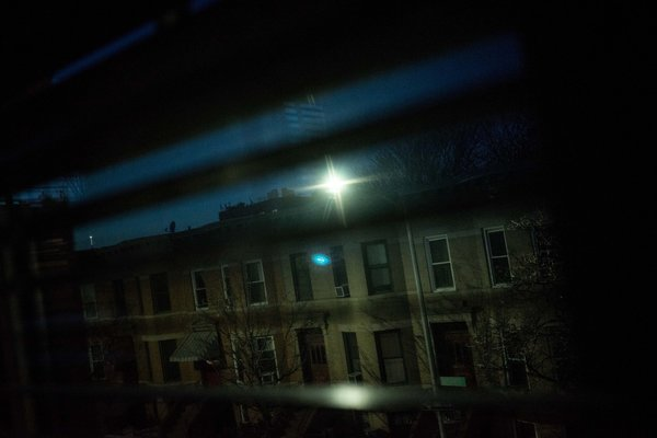 The view from a bedroom in Christopher Stoddard's home in Windsor Terrace, with a glaring streetlight that shines into the room and makes it hard to sleep. Credit Andrew Renneisen from The New York Times