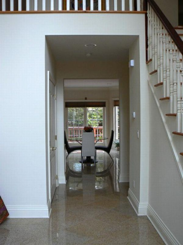 Placing furniture in between is a way to remedy the effects when the front door aligns with the back door.
