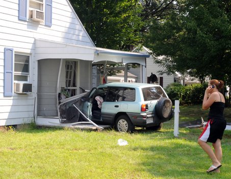 Cars crashing into the house is the one of the reasons why people don't like living at a house facing a T-junction. Springfield- Staff Photo by Mark M.Murray.