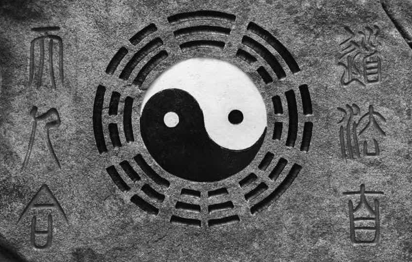 yin-ynag-inscription-on-rock-min (Demo)